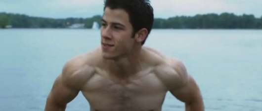 "Nick Jonas Flexes Giant Arms In New ""Kingdom"" Trailer"