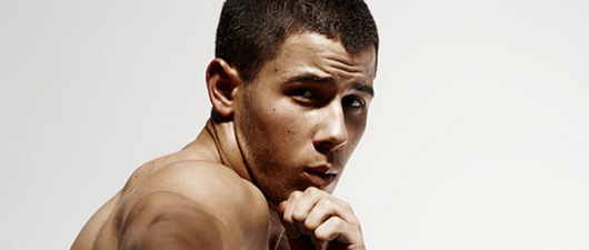 Nick Jonas Is Shirtless And Flexing Again!